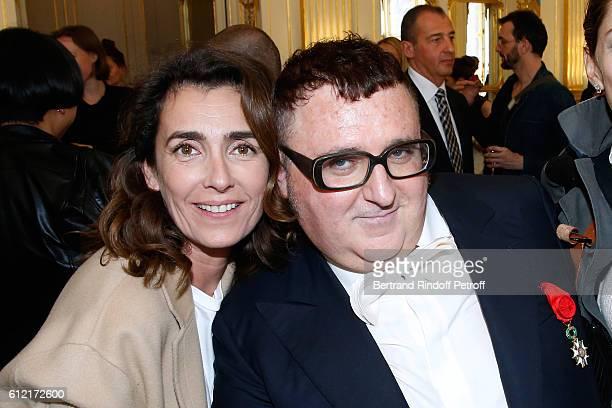 Mademoiselle Agnes Boulard and Alber Elbaz attend Alber Elbaz receives the Insigna of 'Officier de la Legion d'Honneur' at Ministere de la culture as...