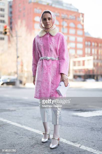 Mademoiselle Meme is seen on the street attending Colovos and Noon By Noor during New York Fashion Week wearing a pink fur coat and silver pants on...