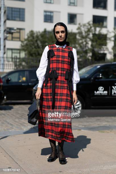 Mademoiselle Meme is seen on the street attending New York Fashion Week SS19 wearing a red/black plaid dress on September 6, 2018 in New York City.