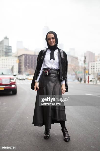Mademoiselle Meme is seen on the street attending R13 during New York Fashion Week wearing a black sweater with leather skirt on February 10 2018 in...