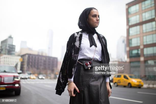 Mademoiselle Meme is seen on the street attending R13 during New York Fashion Week wearing a black sweater with leather skirt on February 10, 2018 in...