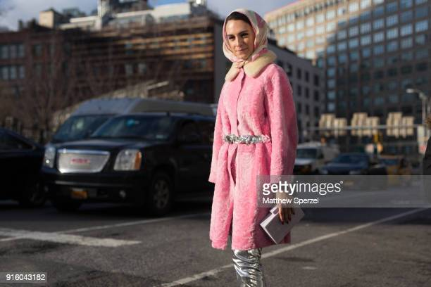 Mademoiselle Meme is seen on the street attending Tadashi Shoji during New York Fashion Week wearing a pink coat and silver pants on February 8 2018...