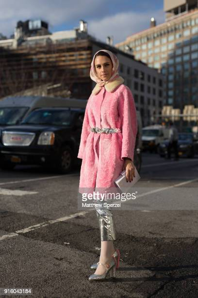 Mademoiselle Meme is seen on the street attending Tadashi Shoji during New York Fashion Week wearing a pink coat and silver pants on February 8, 2018...