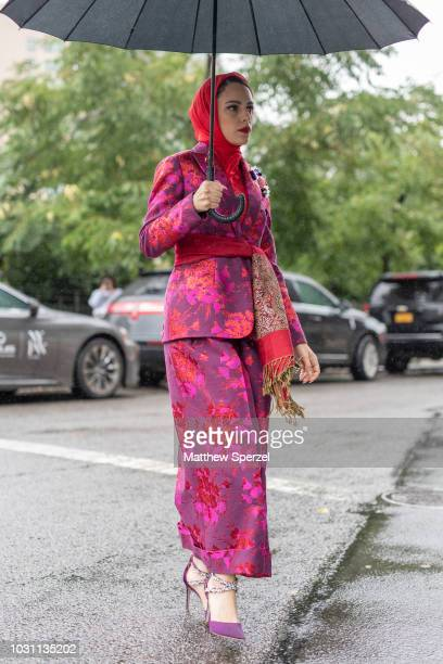 Mademoiselle Meme is seen on the street during New York Fashion Week SS19 wearing floral pattern pink/red suit with red silk head scarf on September...