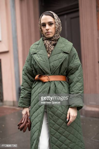 Mademoiselle Meme is seen on the street during New York Fashion Week AW19 wearing leopard print hijab, army green quilted down coat, brown leather...