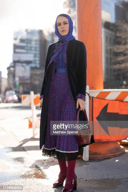 Mademoiselle Meme is seen on the street during New York Fashion Week AW19 wearing purple dress with royal blue hijab on February 09, 2019 in New York...