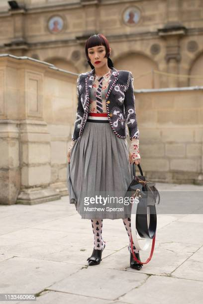 Mademoiselle Yulia is seen on the street attending THOM BROWNE during Paris Fashion Week AW19 wearing THOM BROWNE on March 03 2019 in Paris France