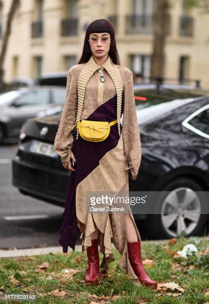 Mademoiselle Yulia is seen wearing a Loewe dress and red boots outside the Loewe show during Paris Fashion Week SS20 on September 27, 2019 in Paris,...