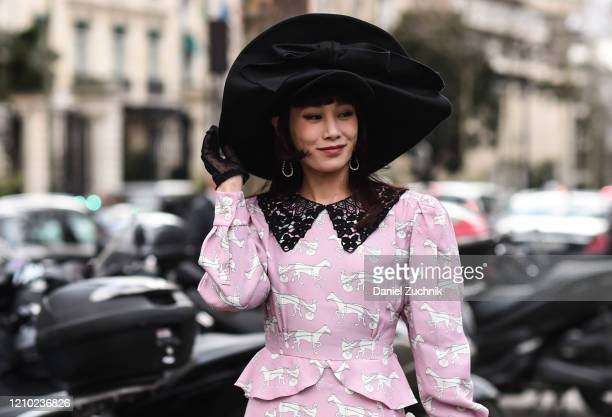 Mademoiselle Yulia is seen wearing a Miu Miu dress and black hat outside the Miu Miu show during Paris Fashion Week AW20 on March 03 2020 in Paris...
