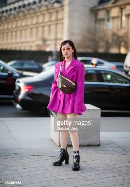 Mademoiselle Yulia is seen wearing belt bag pink dress outside Louis Vuitton during Paris Fashion Week Womenswear Fall/Winter 2019/2020 on March 05...
