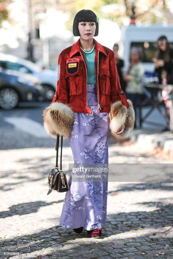 Mademoiselle Yulia is wearing a red jacket, and a purple skirt, outside the Miu Miu show, during Paris Fashion Week Spring Summer 2017, on October 5, 2016 in Paris, France.