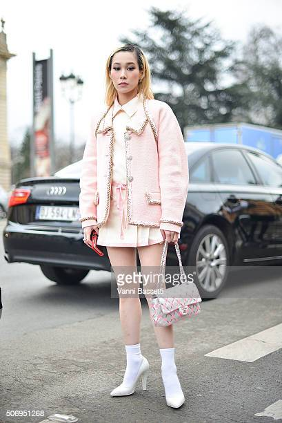 Mademoiselle Yulia poses wearing Chanel before the Chanel show at the Grand Palais during Haute Couture on January 26 2016 in Paris France