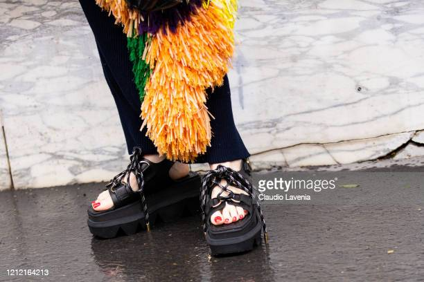 Mademoiselle Yulia, sandals detail, is seen outside Sacai, during Paris Fashion Week - Womenswear Fall/Winter 2020/2021 : Day Eight on March 02, 2020...