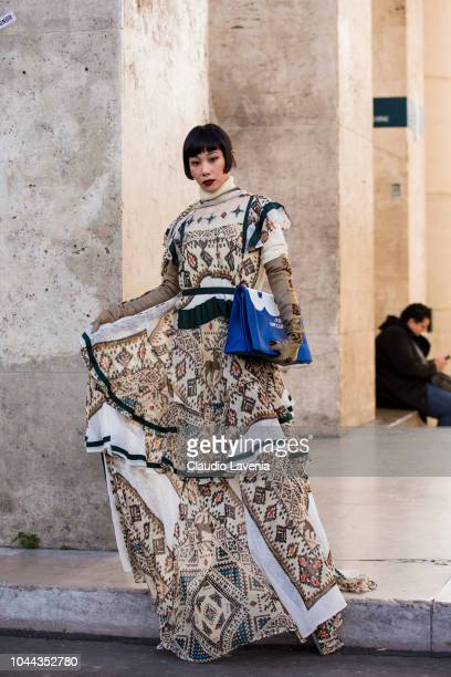Mademoiselle Yulia wearing a maxi printed dress and blue printed bag is seen before the Sacai show on October 1 2018 in Paris France