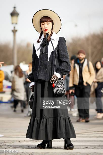 Mademoiselle Yulia wearing Chanel clutch, boater, maxi skirt and a tweed jacket outside Paris Fashion Week Womenswear Fall/Winter 2020/2021 Day Nine...