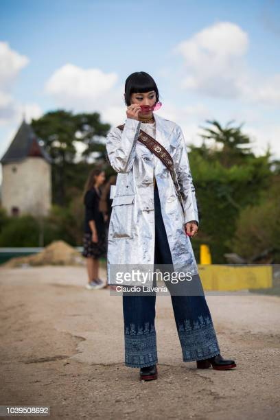 Mademoiselle Yulia wearing grey trench coat and denim pants is seen before the Christian Dior show on September 24 2018 in Paris France