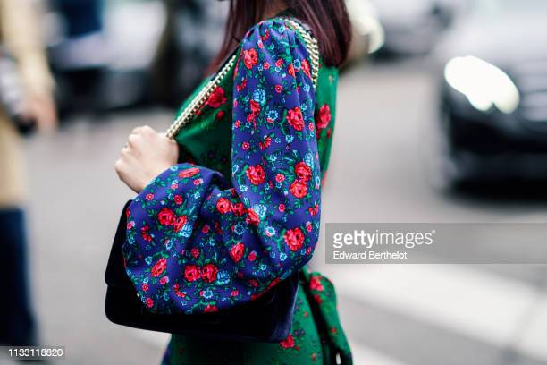 Mademoiselle Yulia wears a green floral print ruffled dress with blue floral print puff sleeves outside Nina Ricci during Paris Fashion Week...
