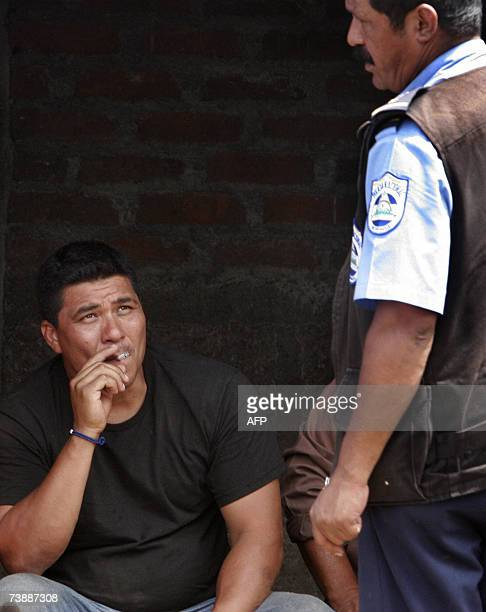 Members of the National Police keep guard of Mexican David Alvarado during an operation against drug cartels in Maderas 75 kilometers north of...