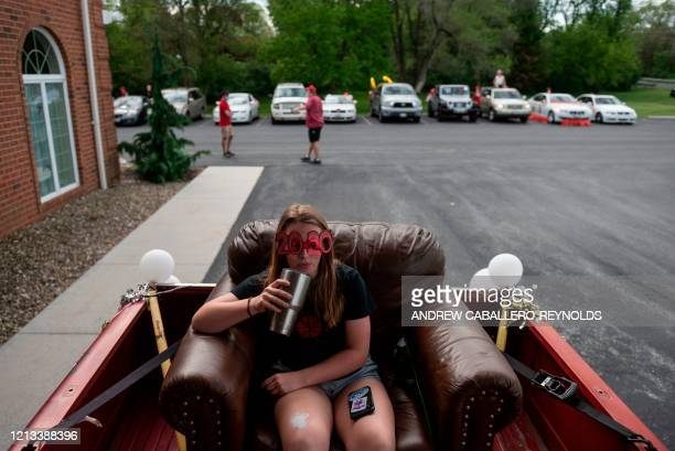 Madey Hill a senior from North Hagerstown High School waits to take part in a senior ride in the back of a truck after prom was cancelled due to the...