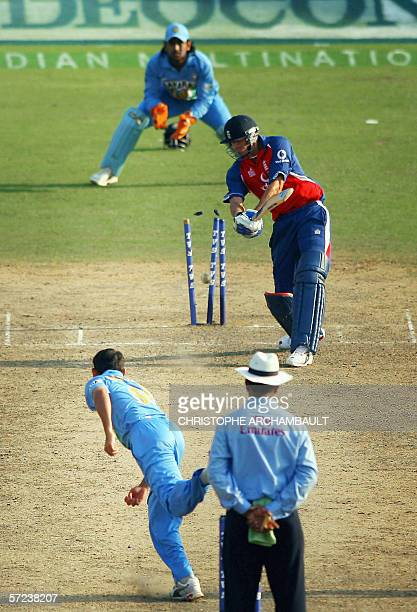 Indian cricketer Ajit Agarkar shatters the wickets of England batsman James Anderson with a delivery during the third OneDay International match...