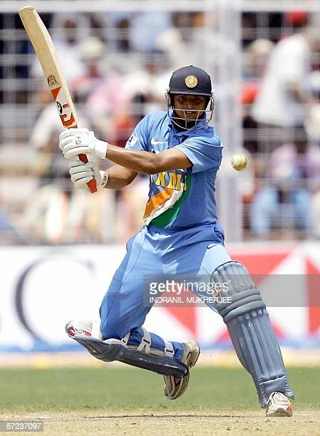 Indian cricketer Suresh Raina defends the wicket during the third OneDay International cricket match between India and England at the Jawaharlal...