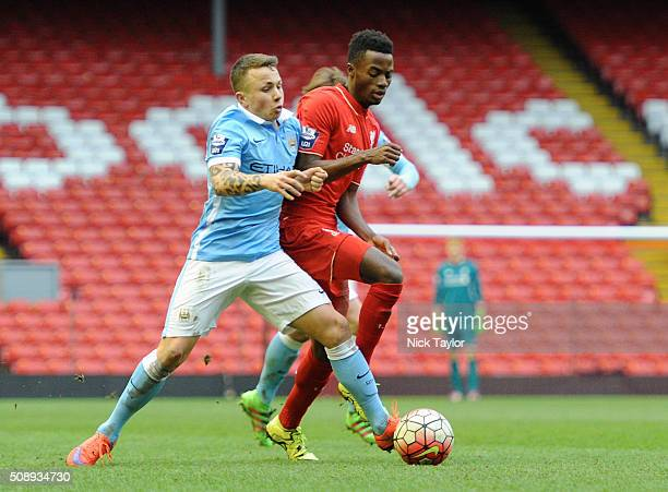 Madger Gomes of Liverpool and Angel Tasende of Manchester City in action during the Liverpool v Manchester City Barclays U21 Premier League game at...