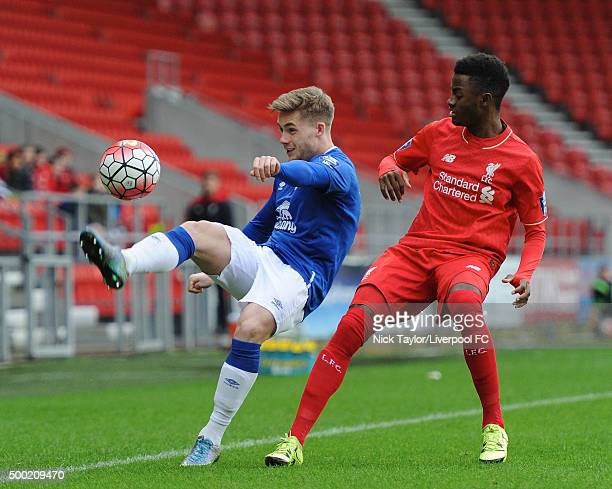 Madger Gomes of Liverpool and Conor McAleny of Everton in action during the Liverpool v Everton U21 Premier League game at Langtree Park on December...