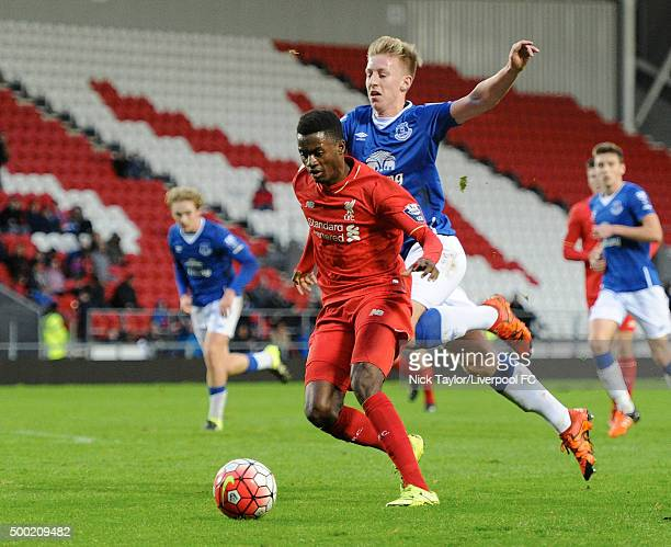 Madger Gomes of Liverpool and Harry Charsley of Everton in action during the Liverpool v Everton U21 Premier League game at Langtree Park on December...