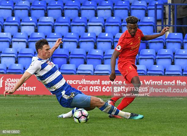 Madger Gomes of Liverpool and Jake Cooper of Reading in action during the Liverpool v Reading Premier League 2 game at Prenton Park on November 20...
