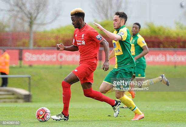 Madger Gomes of Liverpool and Louis McIntosh of Norwich City in action during the Liverpool v Norwich City U21 Premier League game at The Kirkby...