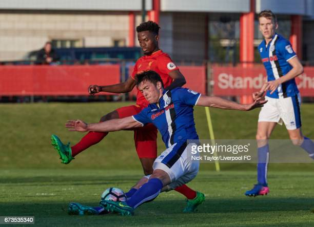 Madger Gomes of Liverpool and Niall Canavan of Rochdale in action during the Liverpool v Rochdale Lancashire Senior Cup SemiFinal at The Kirkby...