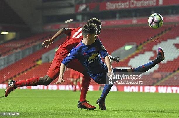Madger Gomes of Liverpool and Regan Poole of Manchester United in action during the Liverpool v Manchester United Premier League 2 game at Anfield on...