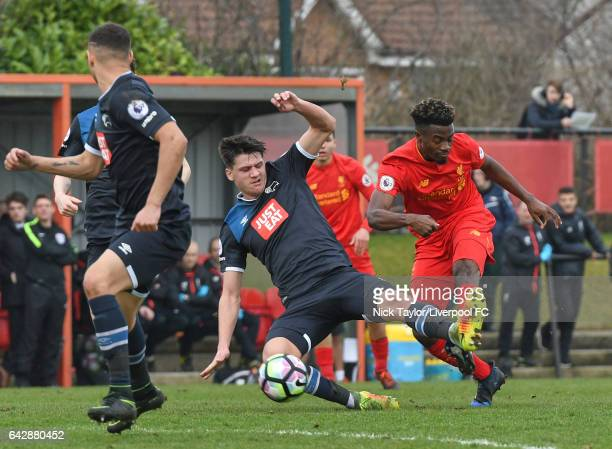 Madger Gomes of Liverpool and Sven Karic of Derby County in action during the Liverpool v Drby County Premier League 2 game at The Academy on...
