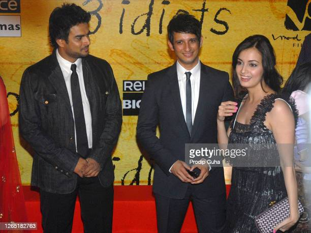 """Madhavan, Sharman Joshi and Dia Mirza attend the film premiere of """"3 Idiots"""" on December 23, 2009 in Mumbai, India."""