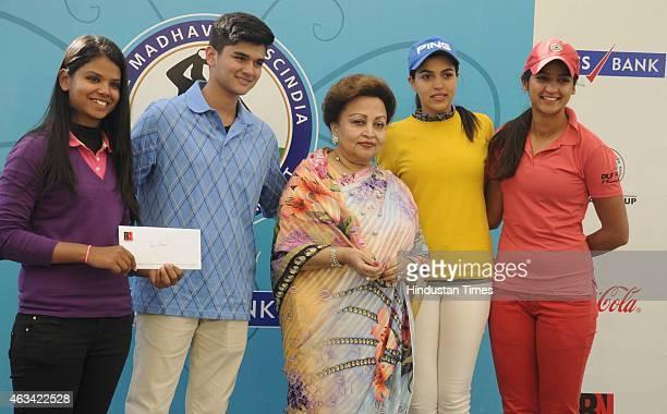 Madhavi Raje Scindia mother of Jyotiraditya Madhavrao Scindia Member of Parliament presents the prize to Vani Kapoor Neha Tripathi and Gauri Monga in...