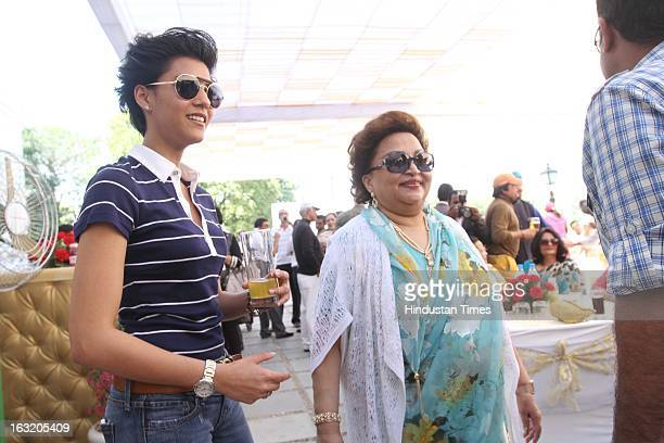 Madhavi Raje Scindia with Mriganka Singh during Madhavrao Scindia Golf Tournament 2013 at DLF Country Club on March 3 2013 in Gurgaon India
