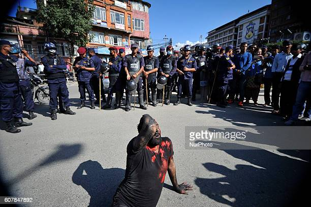 A Madhesi artist protest by demonstrating as an injured victim during celebration of first anniversary of Constitution Day at Maitighar Kathmandu...