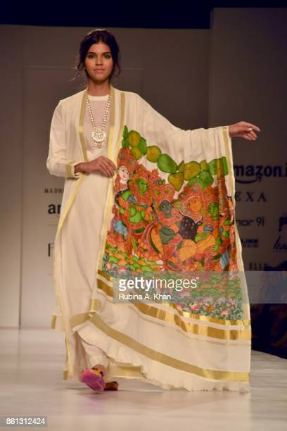 Madhu Jain's celebratory collection in ivory gold and black at the Fashion Design Council of India's 30th edition of India Fashion Week Spring Summer...
