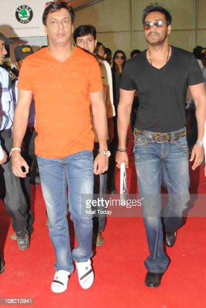 Madhur Bhandarkar and Ajay Devgan along with cast of the movie Dil Toh Bacha Hai Jee' at the inauguration of 'Mumbai International Motor' show at...