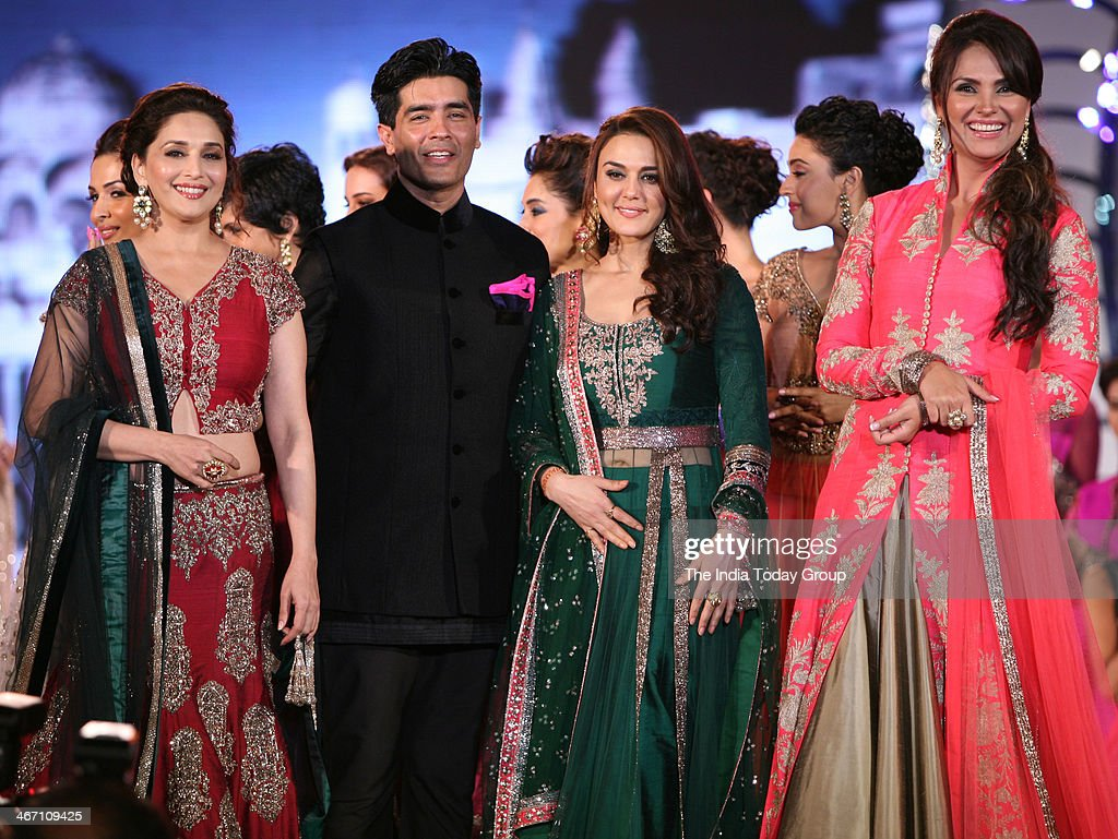 Madhuri Dixit Lara Dutta and Prety Zinta wear designs by Indian designer Manish Malhotra during a fashion show to support the cause of saving and...