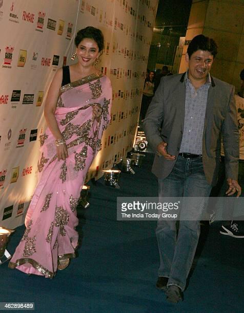 Madhuri Dixit with her husband Sriram Nene at the Filmfare awards PreParty in Mumbai