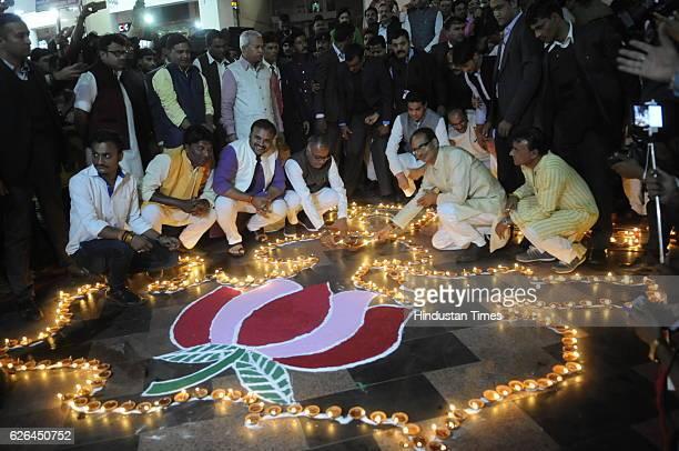Madhya Pradesh Chief Minister Shivraj Singh Chouhan along with state BJP president Nand Kumar Singh Chauhan lighting an earthen lamp during a...