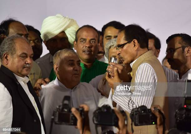 Madhya Pradesh Chief Minister Shivraj Singh Chouhan ends his fast by coconut water offered by former Chief Minister and veteran BJP leader Kailash...