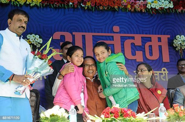 Madhya Pradesh Chief Minister Shivraj Singh Chouhan hugging kids during an inauguration of weeklong programme of Happiness Department 'Anandam' on...