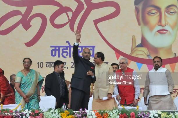 Madhya Pradesh Chief Minister Shivraj Singh Chouhan offering turban to President Ram Nath Kovind during Kabir Mahotsav on November 10 2017 in Bhopal...