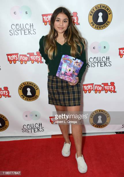 Madi Filipowicz attends The Couch Sisters 1st Annual Toys For Tots Toy Drive held onNovember 20 2019 in Glendale California