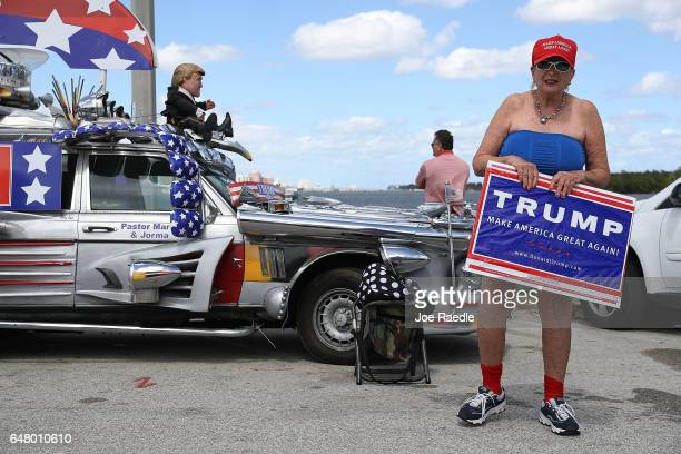 Madi Page shows her support for President Donald Trump near his MaraLago resort home on March 4 2017 in West Palm Beach Florida President Trump spent...