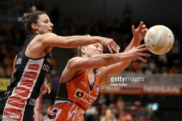 Madi Rbinson of the Magpies Toni Anderson JamieLee Price of the Giants compete for the ball during the Super Netball Major Semi Final match between...