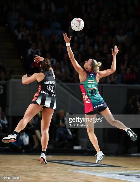 Madi Robinson of the Magpies and Renae Ingles of the Vixens compete for the ball during the round eight Super Netball match between Magpies and the...