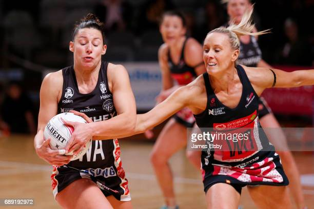 Madi Robinson of the Magpies clashes with Renae Ingles of the Thunderbirds during the round 14 Super Netball match between the Thunderbirds and...